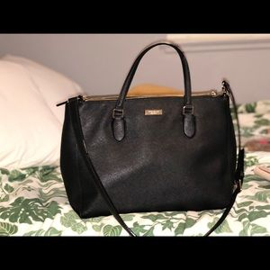 Black Kate Spade purse with strap.